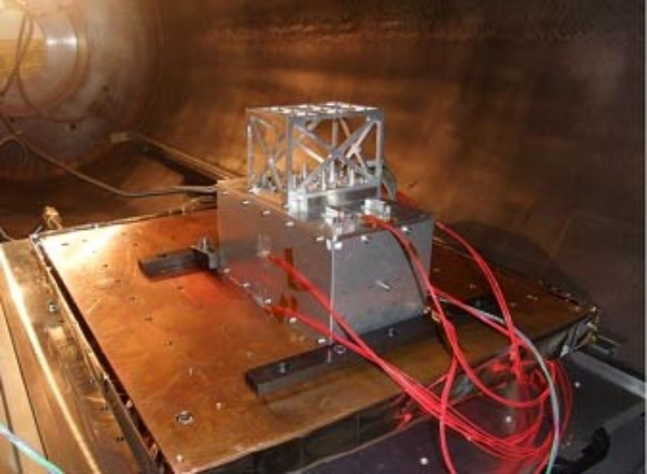 Component equipped with temperature sensors (red) during a test in the thermal vacuum chamber
